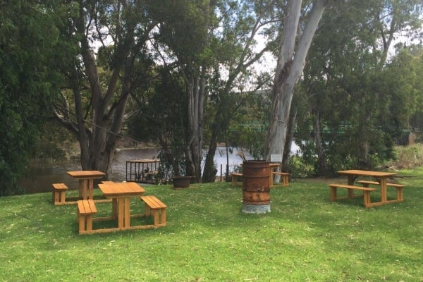Picnic tables and braai next to river